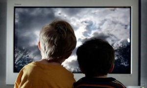Children looking at photos on tv